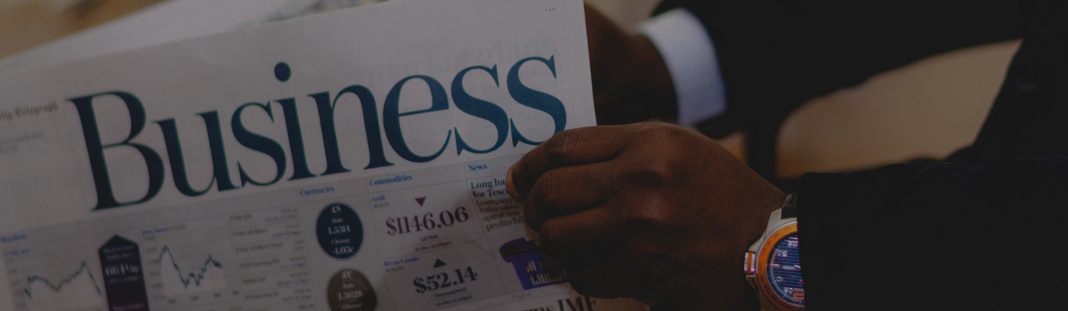Man reading newspaper. Blog post image header.
